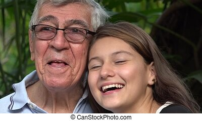 Curious Grandfather And Teen Girl Pointing