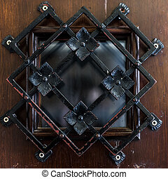 Beautiful latticed window on wooden background close up.