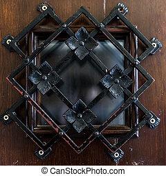 Beautiful latticed window on wooden background close up.