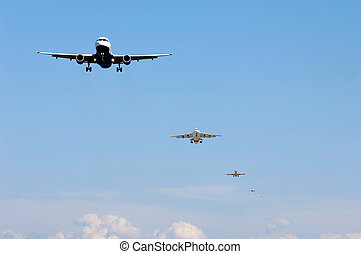 Planes ready to land - Many planes fly in a row ready to...