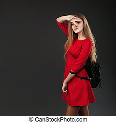 Portrait of a girl in a red dress with a black leather...