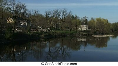 Houses facing Grand River in Elora, Ontario, Canada. Elora...