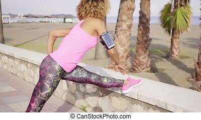 Fit young woman doing stretching exercises - Fit young woman...