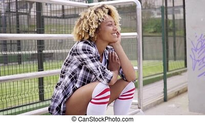 Cute woman in shorts at skating park - Cute young smiling...