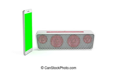 Smartphone and wireless speaker - Smartphone with green...