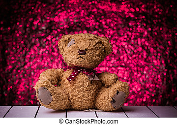 Teddy bear sitting on white wooden floor with nice bokeh...