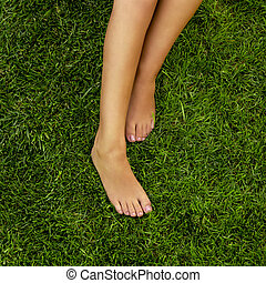 Female legs - Close-up of female legs over the grass
