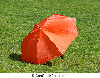 Red Umbrella - Red umbrella on the green grass playground