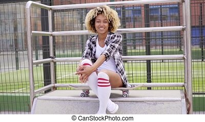 Fun pretty young woman posing on a skateboard - Fun pretty...