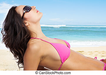 Beautiful beach woman - A beautiful caucasian woman lying...