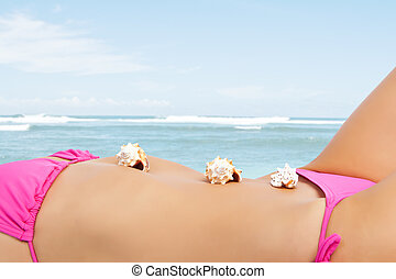 Sexy beach woman - A sexy caucasian woman lying down on the...