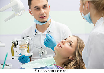 Modern dental clinic, young dentist working