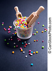 Colored sugar pearls for food decoration