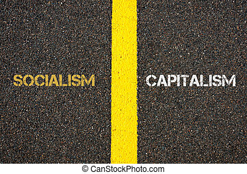 Antonym concept of SOCIALISM versus CAPITALISM written over...