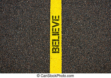 Road marking yellow line with word BELIEVE - Road marking...