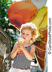 it is a really big ice cream - little blonde girl looking...