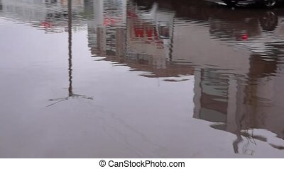 Big pool in city yard in spring - Big puddle in city yard in...