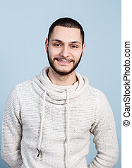 Young handsome man with smile on the blue background