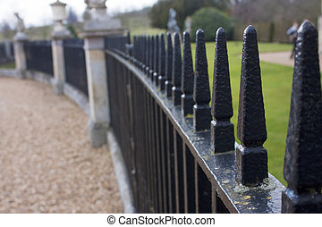 close up of park iron railings in a curved line shape