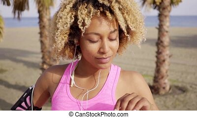 Sexy young African woman listening to music - Sexy young...