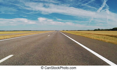 Car road travel on wide field landscape with blue sky