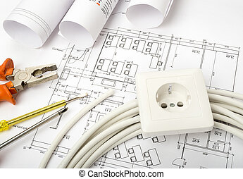 Architecture plan and rolls of blueprints with cable and...