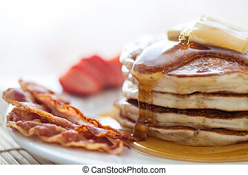 Pancakes with honey, bacon and stra - Pancakes with butter...