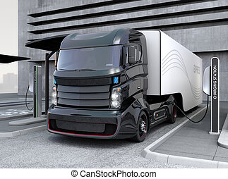 Hybrid electric truck in charging - Hybrid electric truck...