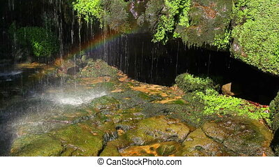 Small waterfall and rainbow