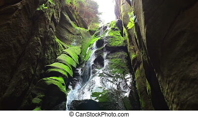 Waterfall in cave in Adrspach Czech mountains