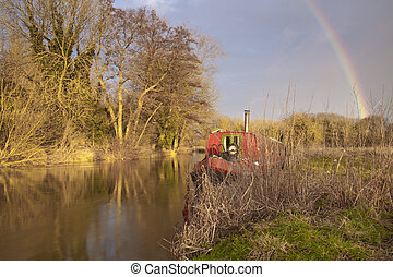 Rainbow and winter storm clouds over the River Kennet at...