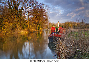 Moored narrowboat in the winter afternoon light on the River...