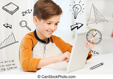 smiling boy with tablet pc computer at home - leisure,...