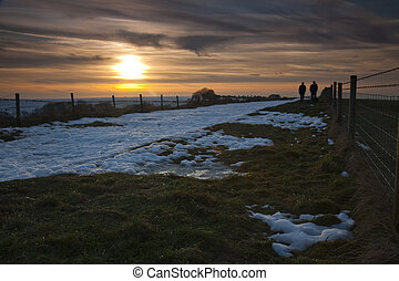 Walkers on the Wayfarers footpath close to Coome Gibbet in...