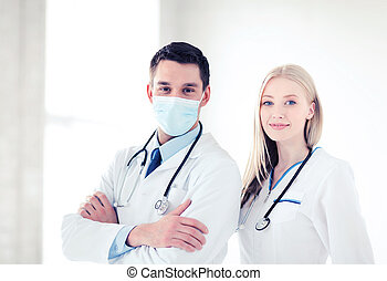 two young attractive doctors - healthcare and medical...