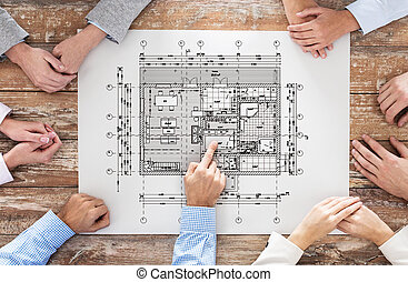 close up of business group with blueprint - business,...