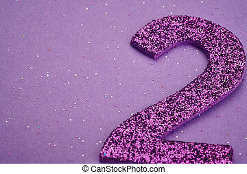 Number two purple color over a purple background Anniversary...