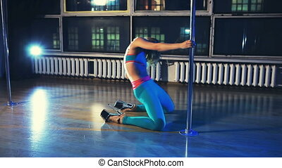 Young woman pole dance clip