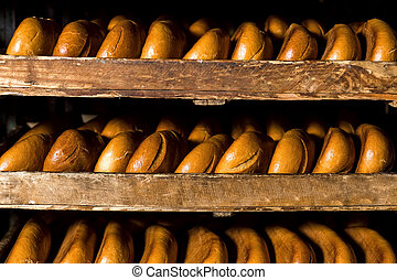 Selling bread. Bread is on the shelves. Bread stacked on the...