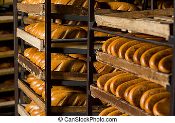 Bread stacked on the shelves. - Selling bread. Bread at the...