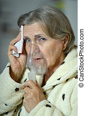woman with inhaler - Portrait of a senior woman with inhaler