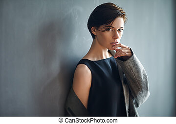 Portrait of sexy fashion woman on dark background