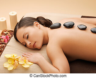 beautiful woman with hot stones
