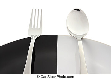 Spoon and fork with plate