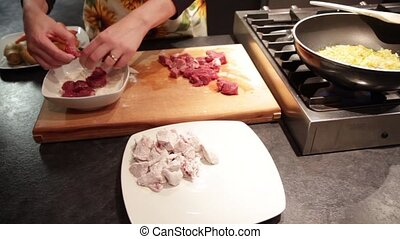 Stew meat preparation with potatoes and carrots, cut and...
