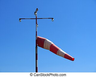 Windsock at airport against blue sky