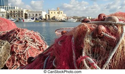Fishing nets on the docks in the old port of Gallipoli,...