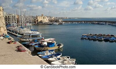 Fishing and sailing boats docked in the port of the old town...