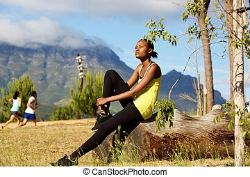 Woman taking break from running workout - Portrait of young...