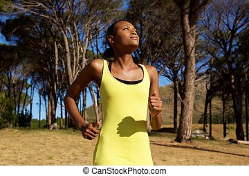 Healthy young african american woman jogging